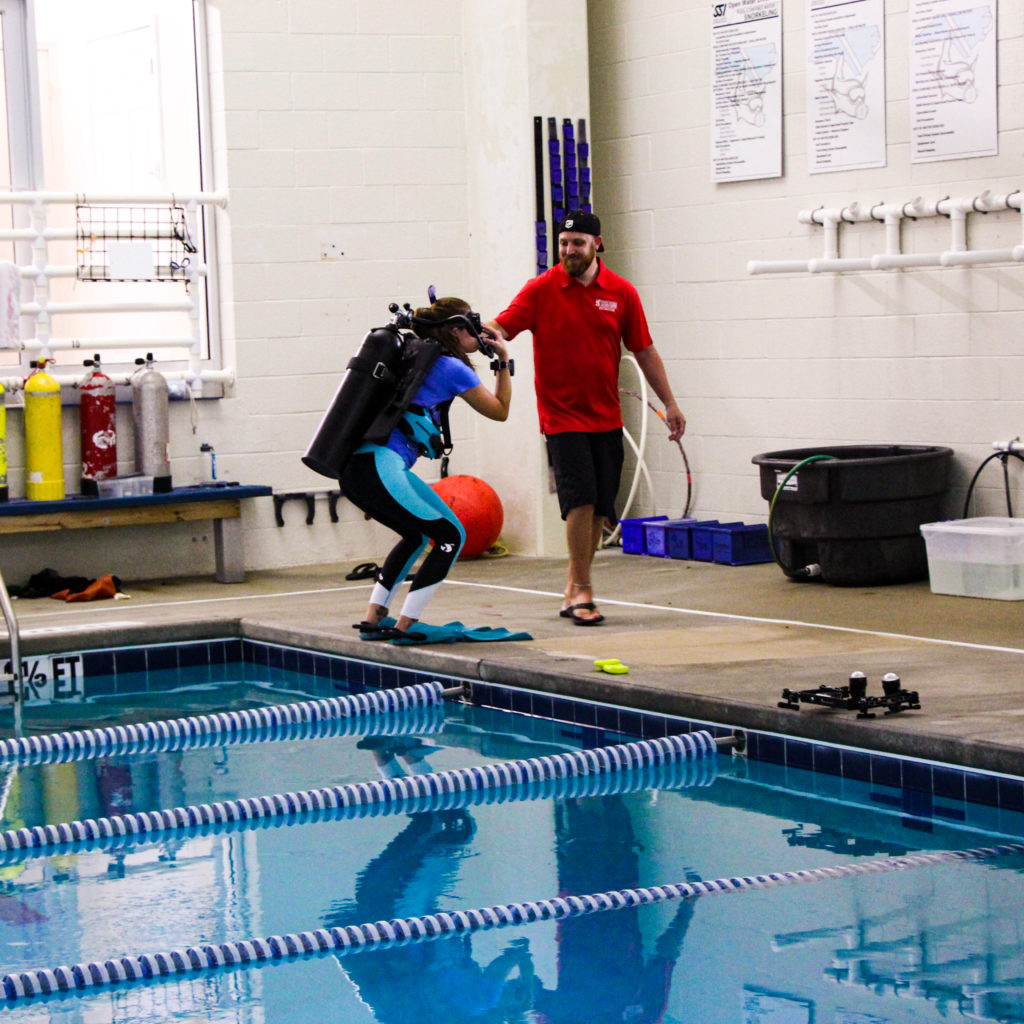 An instructor and student in the training pool