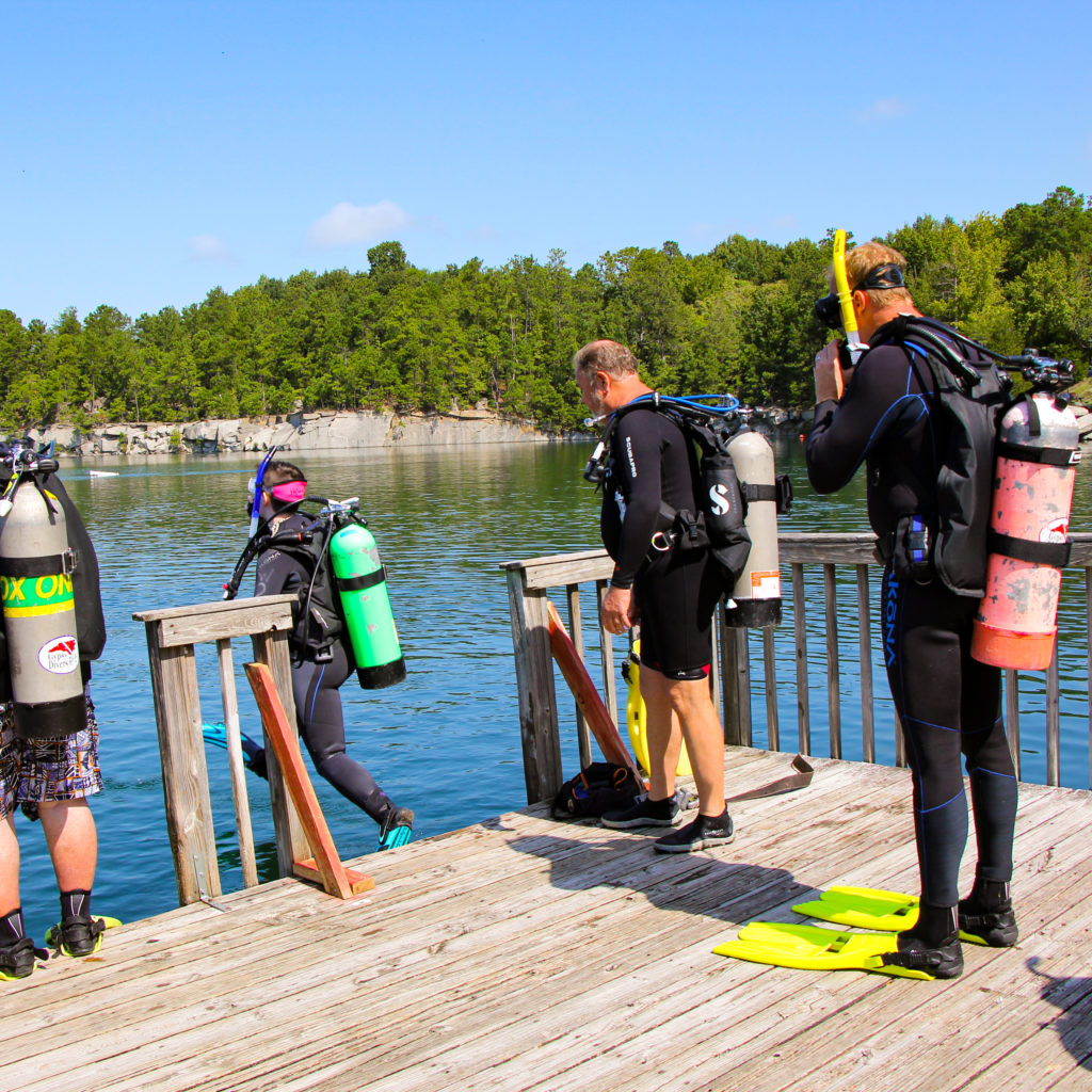 Dive students practicing their giant strides into the quarry