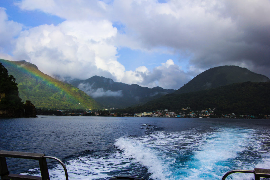 Rainbow over the city coming back from a dive