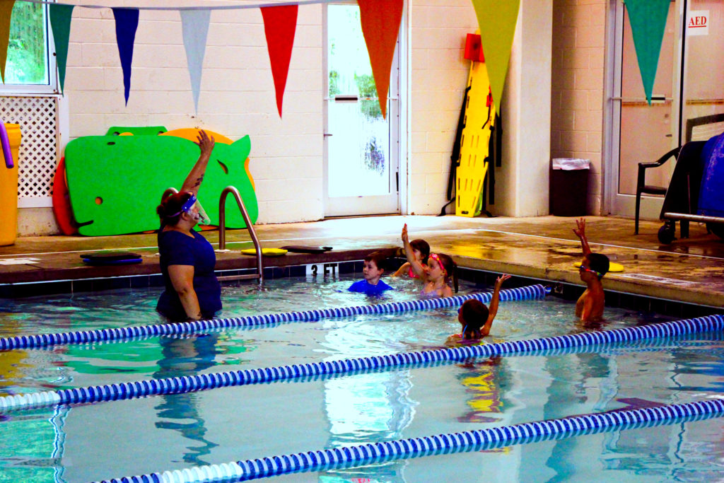 Students following their swim instructor's lead.
