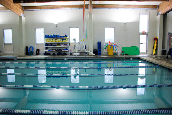 The training pool with water aerobics equipment and pool toys for lessons.