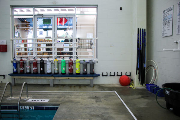 The training pool with tanks lined up on a bench and ranks for trying equipment.
