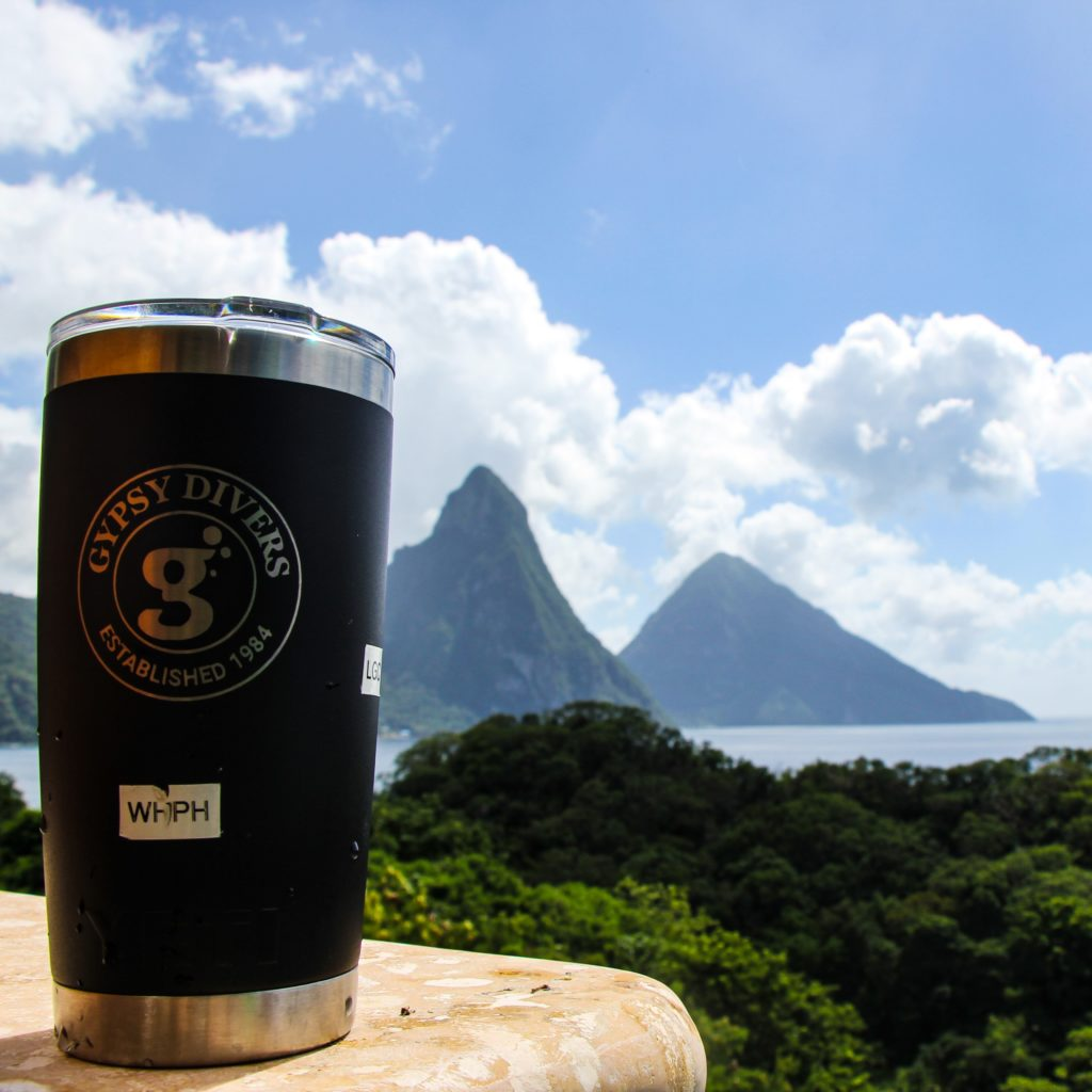 The gypsy divers travel mug with the Piton mountains in the background